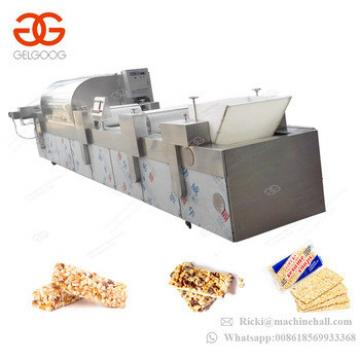 Trade Assurance Cereal Energy Bar Extruder Sesame Peanut Candy Groundnut Chikki Making Plant Snack Bar Nougat Cutting Machine